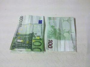 Origami-Sonne aus Geldschein falten - Schritt 2