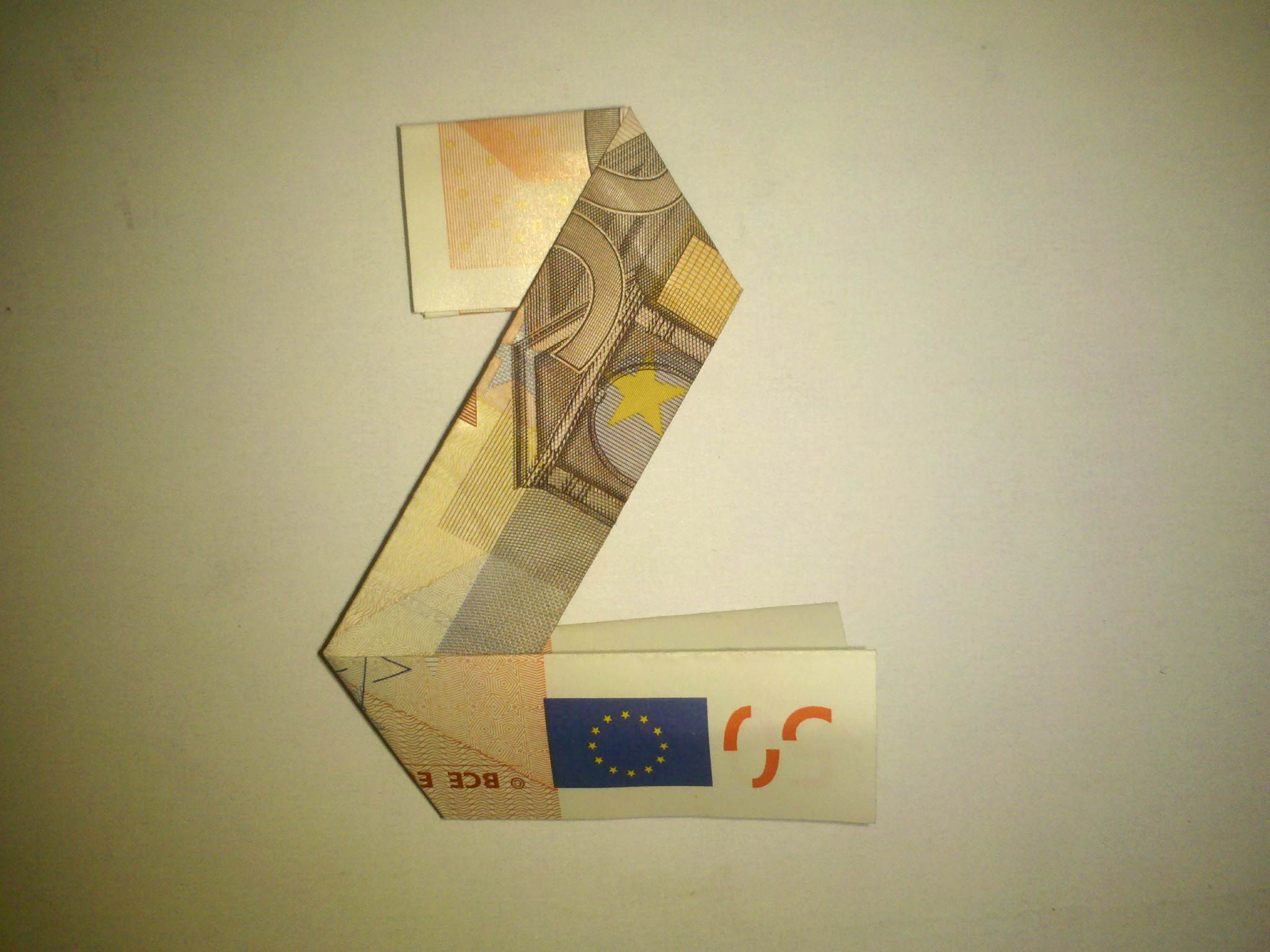 Origami: Number 2 folded from a banknote