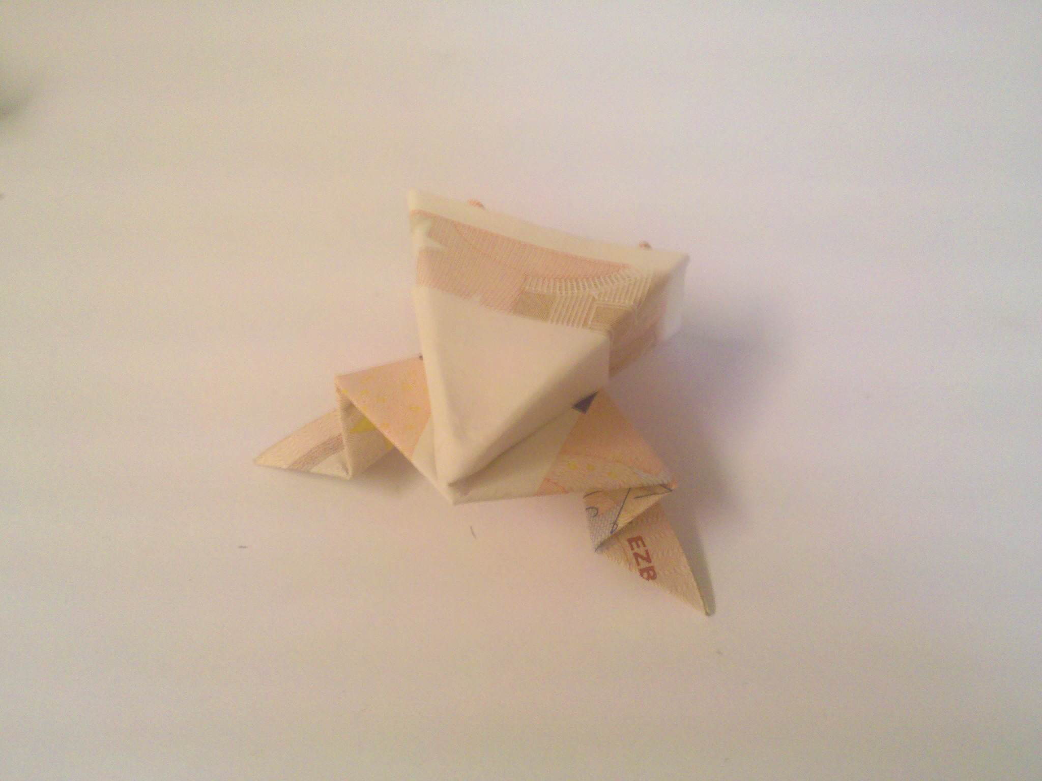 Origami frog folded from bills