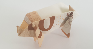 Pig folded out of a bank note - standing