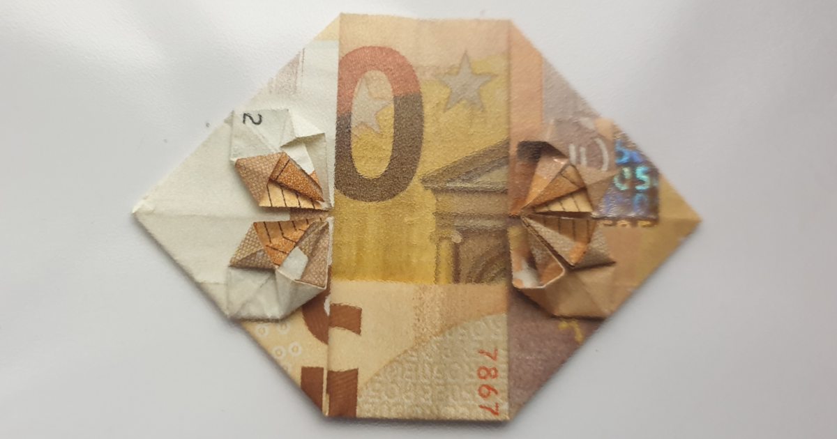 Folding a heart with a flower from a banknote - step 19