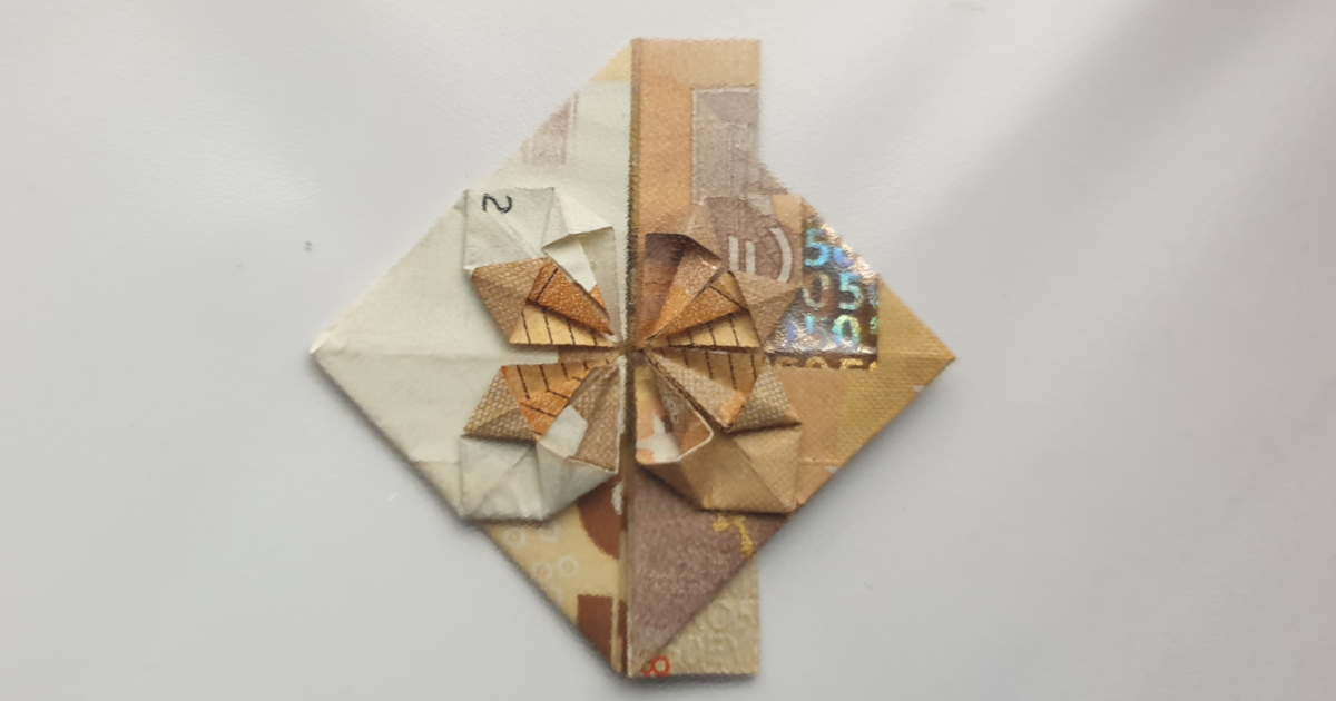 Folding a heart with a flower from a banknote - step 21