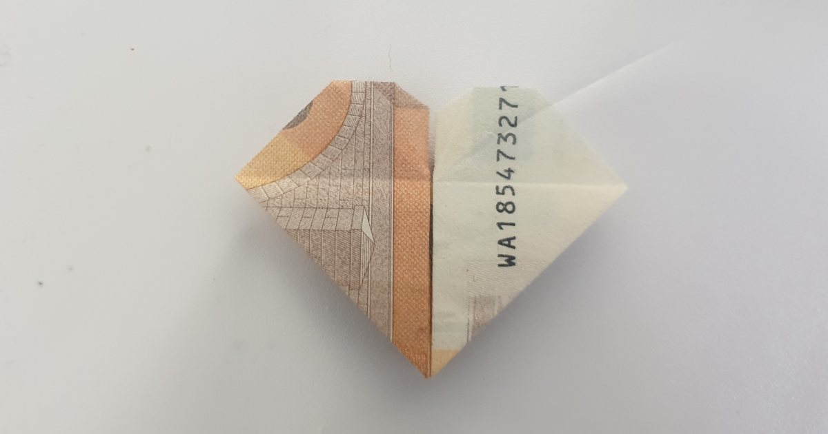 Folding a heart with a flower from a banknote - step 23