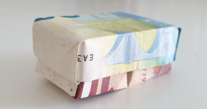 Box with lid folded out of banknotes